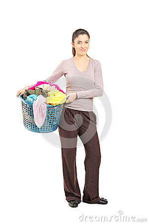 Smiling female holding a laundry basket