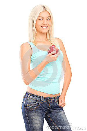 A smiling female holding a red apple