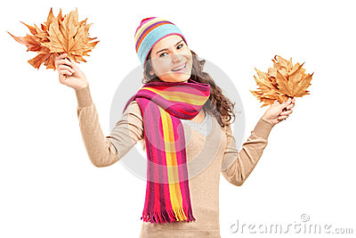 Smiling female holding tree leaves
