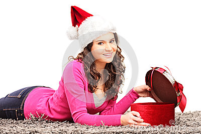 Smiling female lying down and opening gift