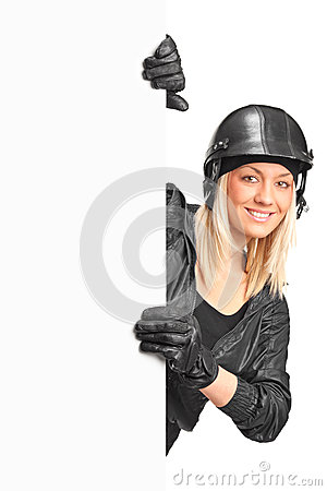 Smiling female motorcyclist holding a blank panel