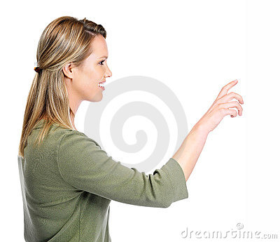 Smiling female pointing out at copyspace
