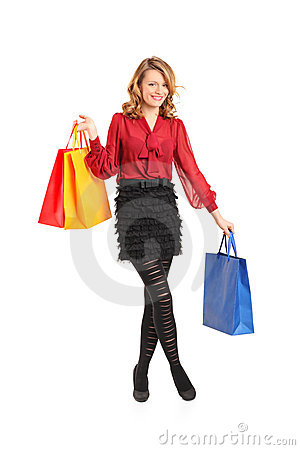 Smiling female posing with shopping bag