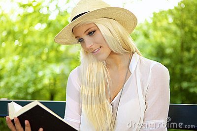 Smiling female reading