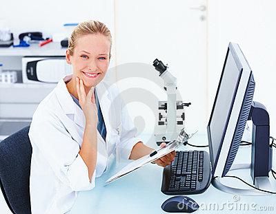 Smiling female researcher sitting with computer