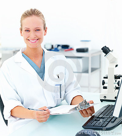 Smiling female researcher sitting at a laboratory