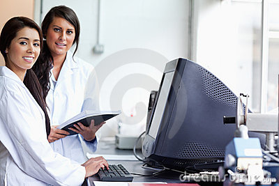 Smiling female scientist posing with a monitor