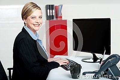 Smiling female secretary at work