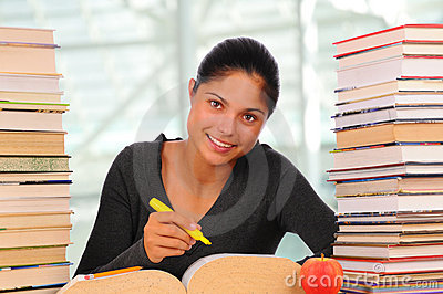 Smiling Female Student with Books