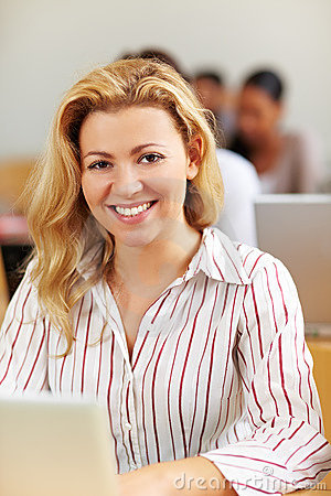 Smiling female student at laptop