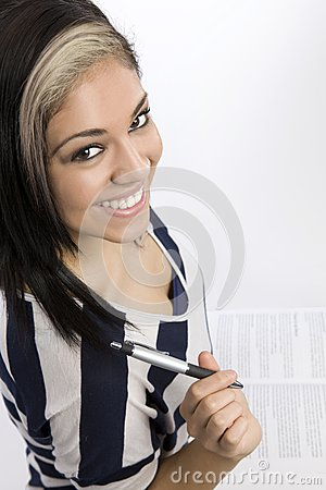 Smiling Female Student with Textbook