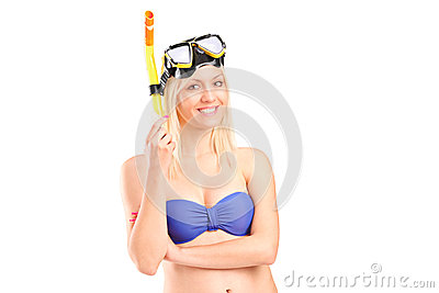 Smiling female in swimsuit posing with snorkeling mask