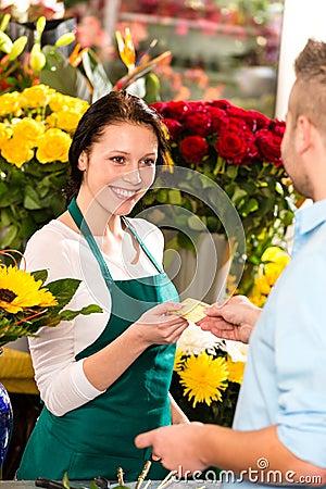 Smiling florist man customer buying flowers card