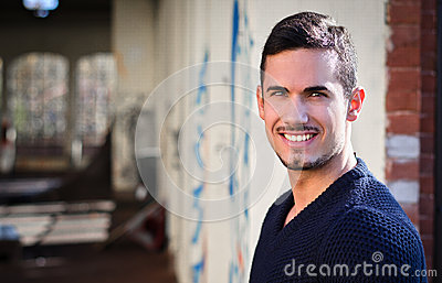 Smiling, friendly young man looking at camera, large copyspace