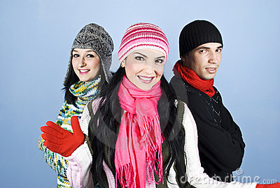 Smiling friends in winter clothes