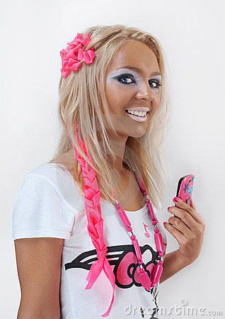 Smiling ganguro style girl with cell phone