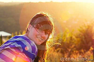 Smiling girl against sunlight
