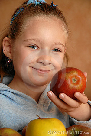 Smiling girl with apples