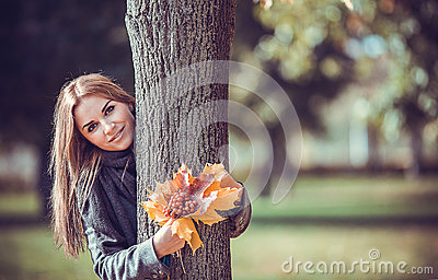 Smiling girl with autumn bouquet