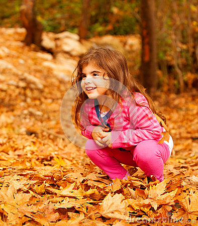 Smiling girl in autumn park