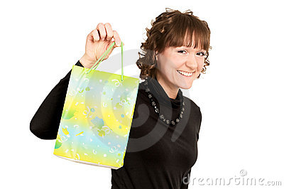 Smiling girl buyer with present bag