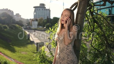 Smiling girl chatting on smartpone outdoors stock video footage