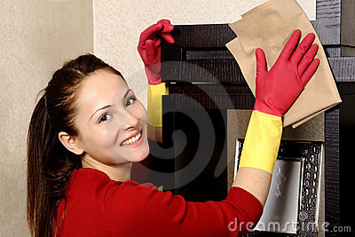 Smiling girl cleaning the house