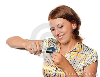 Smiling girl cuts a credit card