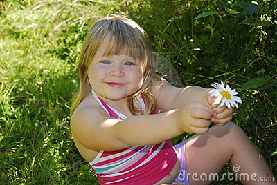 Smiling girl with daisy
