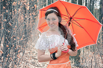 Smiling girl with a decorative umbrella