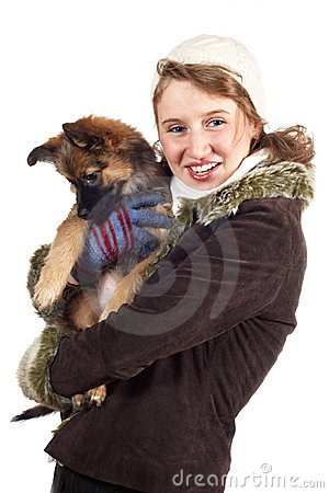 Smiling girl with dog in winter coat