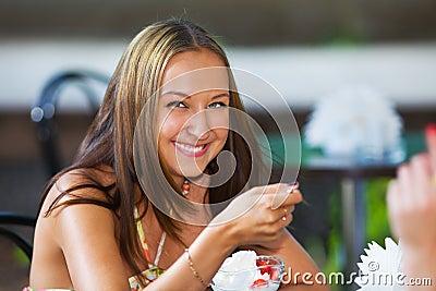 Smiling girl eating ice scream