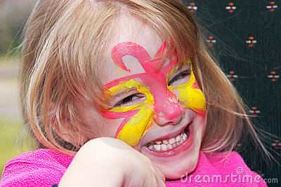 Smiling girl with face paint
