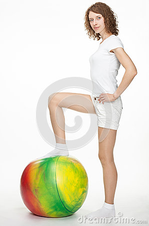 Smiling girl with a fitball