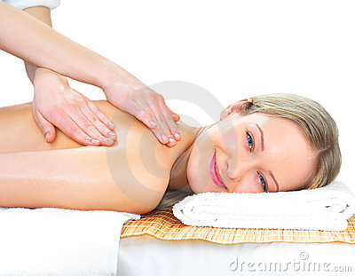 Smiling girl getting a massage
