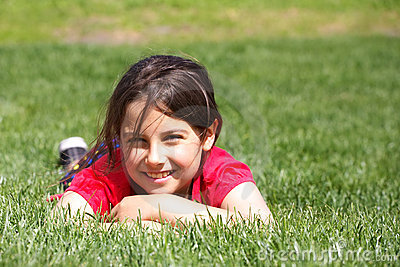 Smiling girl in grass