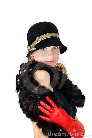 Smiling girl in hat and red gloves