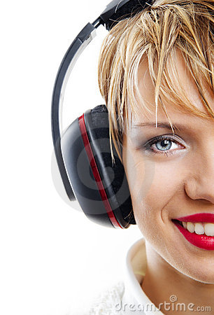 Smiling girl with headphones isolated on white