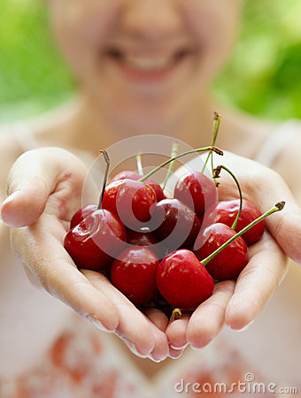 Free Smiling Girl Holding A Handful Of  Cherries Royalty Free Stock Images - 25980519
