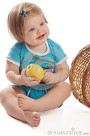 Smiling girl holding apple