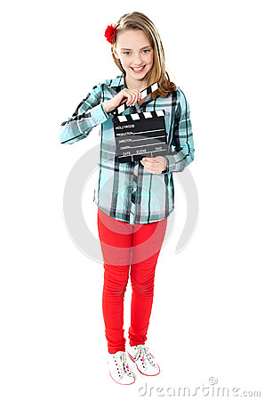 Smiling girl holding clapperboard