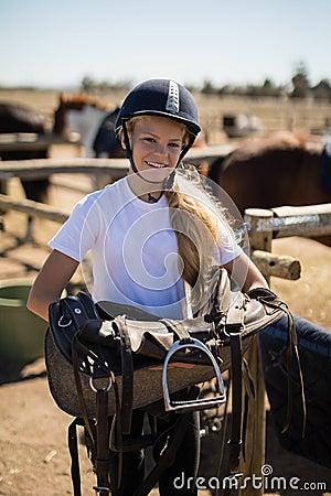 Free Smiling Girl Holding Horse Saddle Royalty Free Stock Photos - 95851688