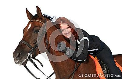 Smiling girl on a horseback