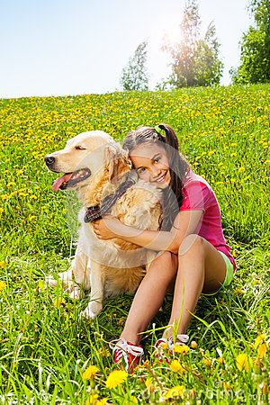 Free Smiling Girl Hugs Cute Dog Sitting On The Grass Royalty Free Stock Photography - 41851997