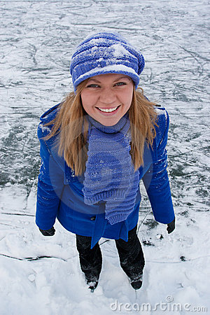 Smiling girl on ice skates.
