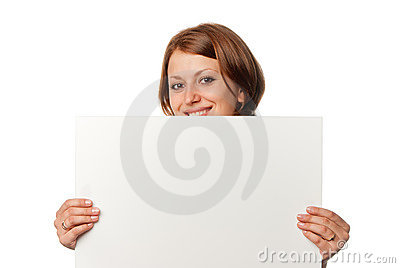 Smiling girl looks out from blank sheet