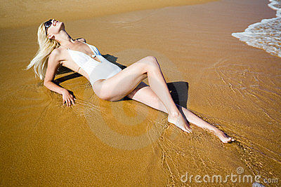 Smiling girl lying beach