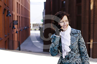Smiling girl with a mobile