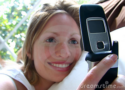 Smiling girl with mobile cell phone