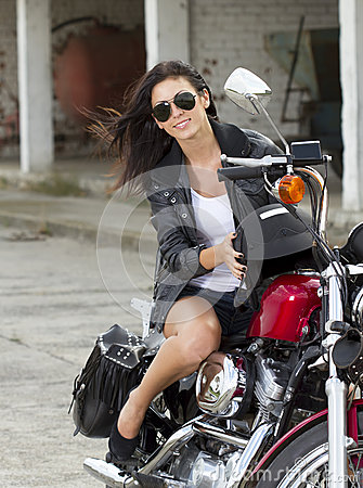Smiling girl on a motorcycle